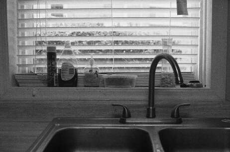 Kitchen sink, shot on a Canon AE-1 with Kodak TMax P3200