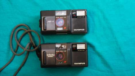 Double feature: Olympus' AF-1, and Infinity Quartzdate